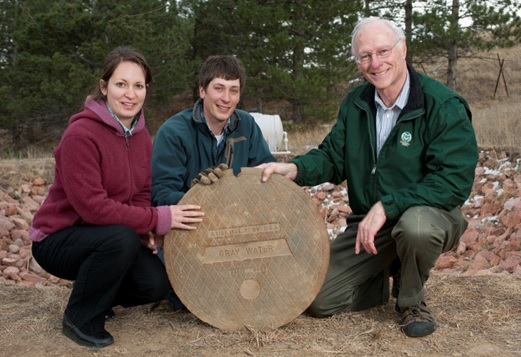 Sybil Sharvelle (left), Adam Jokerst (center) and Larry Roesner (right) pictured with graywater person hole located at CSU constructed wetlands for graywater treatment